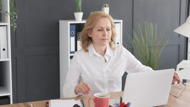 Businesswoman working on laptop at office