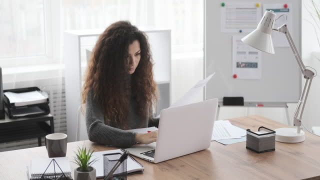 Businesswoman working on office laptop