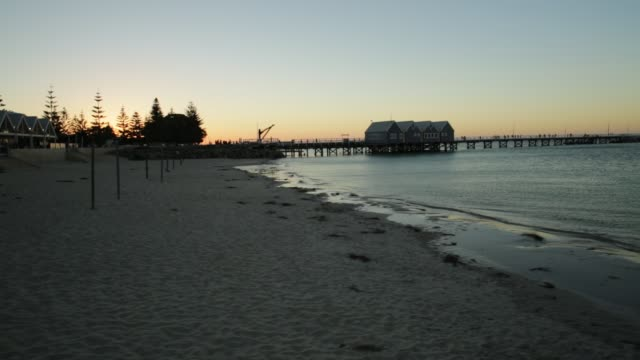 Busselton jetty sunset Scenic landscape of iconic Busselton Jetty in Busselton Beach, Western Australia at sunset light. Busselton Jetty is the longest wooden pier in the world. jetty stock videos & royalty-free footage