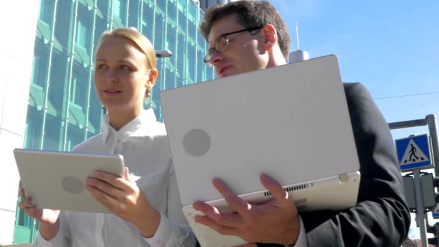 Busy businesspeople with electronics in the city video