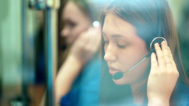 Busy call center operators in a modern office video