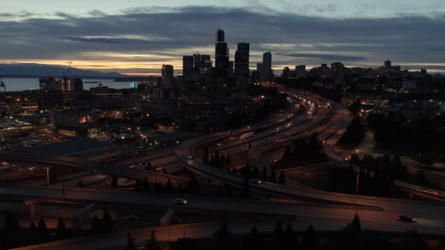 Busy City Aerial Hyperlapse of Cars Driving by Skyline Drone dolly with Seattle downtown cityscape moving in fast motion at night seattle stock videos & royalty-free footage