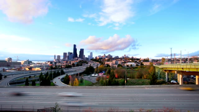 busy expressway and cityscape in blue sky timelapse video