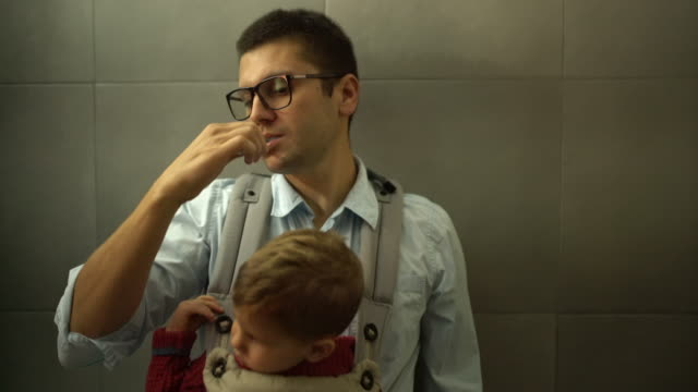 Busy father brushing his teeth video