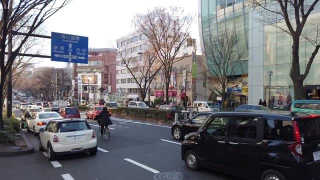 upptagen harajuku street på harajuku, tokyo - billboard train station bildbanksvideor och videomaterial från bakom kulisserna