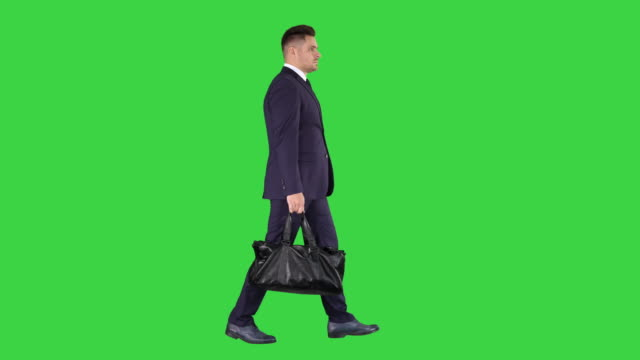 Busy man walking on street with briefcase on a Green Screen, Chroma Key
