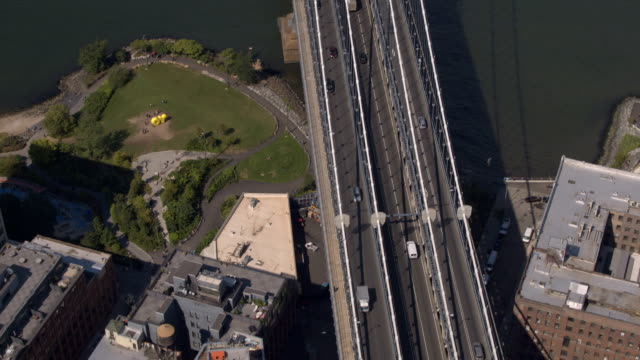 AERIAL: Busy Manhattan bridge highway running from Brooklyn into New York City video