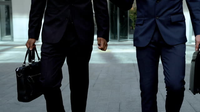 busy men walking together near office building, lawyer or members of commission - controllo video stock e b–roll