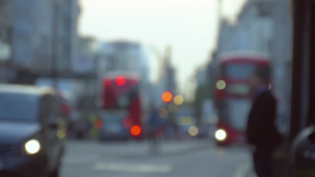 Busy Oxford street with buses and taxi, blurred
