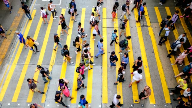 busy pedestrian crossing at hong kong - time lapse - ingorgo stradale video stock e b–roll
