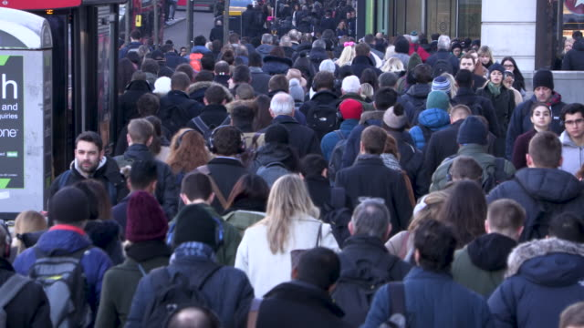 Busy pedestrians commuting during rush hour