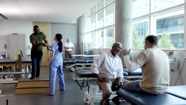 busy physical therapy rehabilitation center - fisioterapia video stock e b–roll