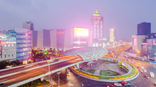 busy road by the new station and modern buildings in shanghai time lapse 4k video