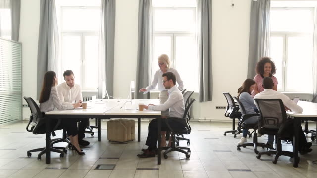 Busy rush working hours of diverse employees in coworking space