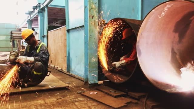 Busy Shift at the Steel Pipe Factory Factory, Welder, Business, Skills, Part of a Series - Steel Pipe Factory Workers Busy with Respective Jobs in hand gas pipe stock videos & royalty-free footage