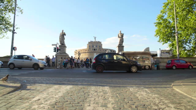 Busy street traffic near Castel Sant Angelo in Rome, urban life, transportation video