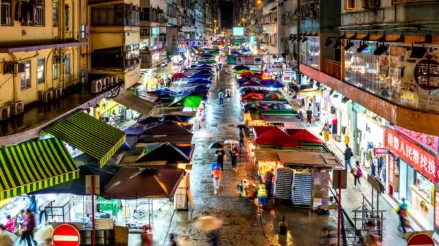 livliga gator i mongkok, kowloon, hong kong - välstånd bildbanksvideor och videomaterial från bakom kulisserna