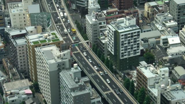 ビューの上に空中から交通渋滞で忙しい東京市道路車 - 渋滞点の映像素材/bロール