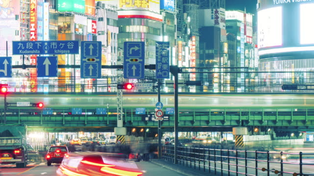 T/L MS Busy Traffic in Shinjuku at Night / Tokyo, Japan
