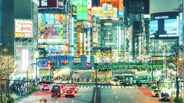 T/L MS Busy Traffic in Shinjuku at Night / Tokyo, Japan, Zoom out