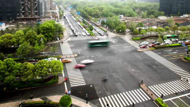 Busy traffic on crossroad in modern city,time lapse and tilt shift lens. video