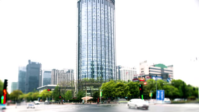 Busy traffic on modern street and buildings in hangzhou,time lapse. video