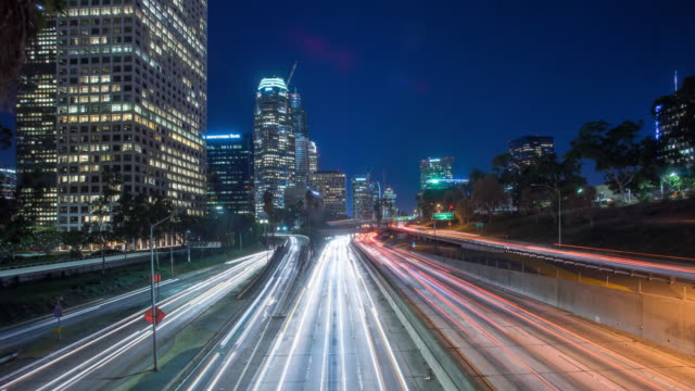 busy traffic through modern city at night in los angeles,timelapse,4k busy traffic through modern city at night in los angeles,timelapse,4k traffic time lapse stock videos & royalty-free footage