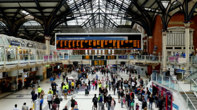 Busy Train Station People Travelling Time-Lapse 4K 4K locked off video time-lapse of people at bust train station in London, England. No recognizable logos or faces. station stock videos & royalty-free footage