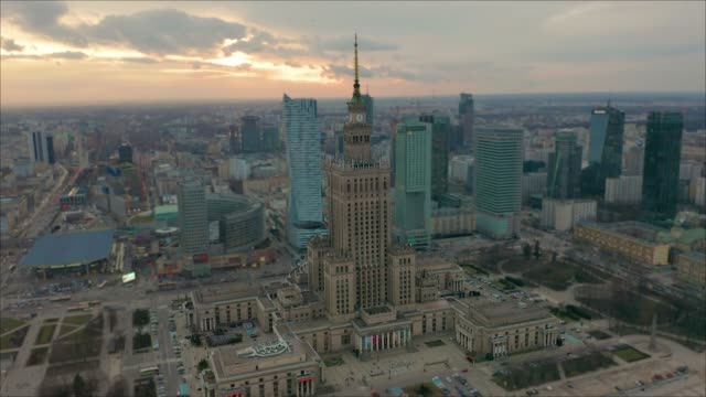 Busy Warsaw city centre with Palace of Culture and Science and other new skyscrapers in the view. One of the highest building of Europe. Aerial view