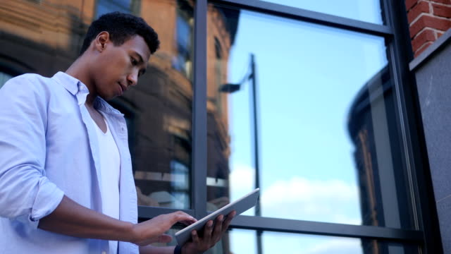 Busy Working Online on Tablet, Standing Young Black Male Designer video