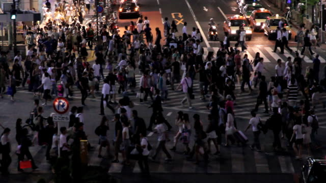 Busy zebra crossing in the night video