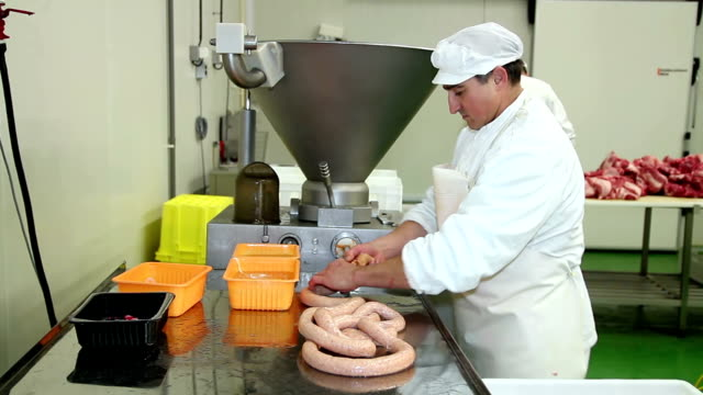 Butcher Making Sausages at Slaughterhouse video