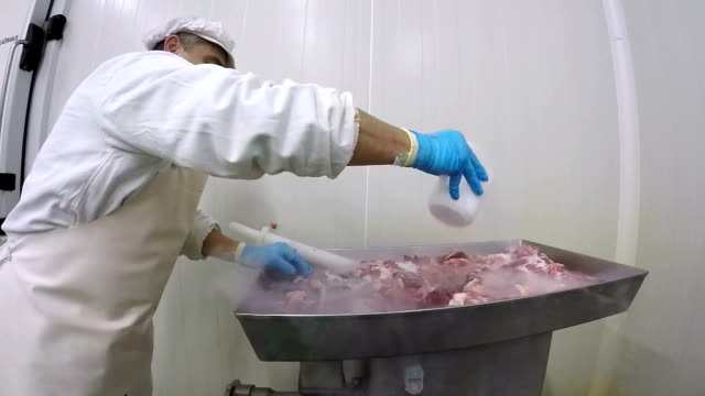 Butcher Pouring Dry Ice on Fresh Meat video