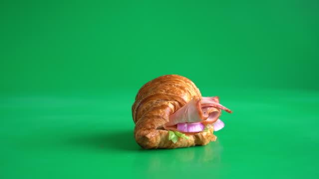 butter croissant ham cheese sandwich on green screen video