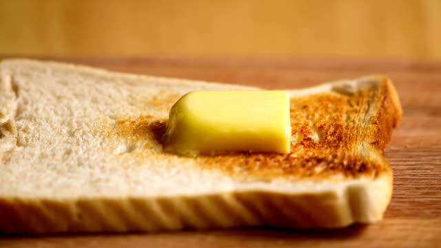 butter melting on bread  in time laspe video