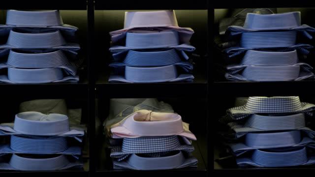 button down shirts on retail shelves display - dobrze ubrany filmów i materiałów b-roll