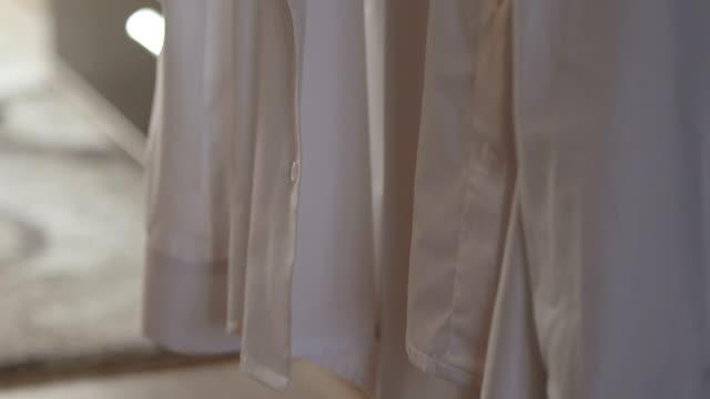 buttonig shirt white video