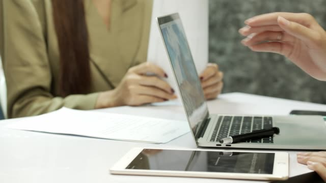 Buy and sell sign Signature in agreement Contract on Tablet together