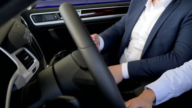 buyer get key from car seller, Handshake, shoot of hands Close-up, Auto business, male with car dealer, man salesman sells automobile video