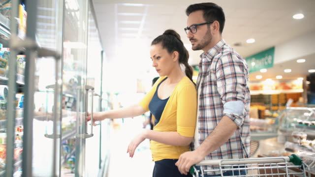 Buying food in supermarket video