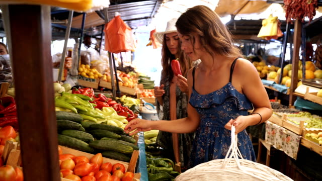 Buying fresh fruits and vegetables on market place video