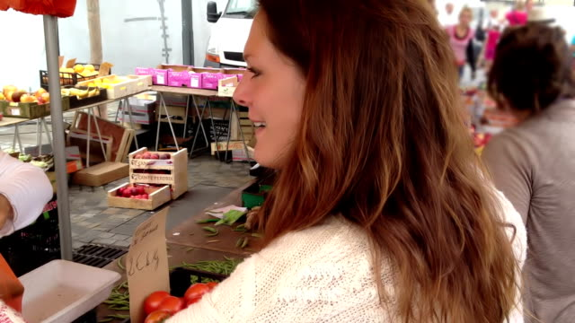 Buying Fruit And Veg At A Market video