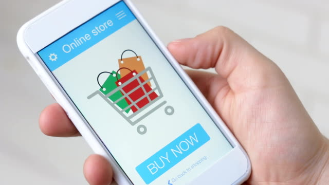 Buying goods in online store using smartphone application Buying goods in online store using smartphone application Using smartphone application shopping online stock videos & royalty-free footage