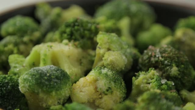 cabbage broccoli in a pan with oil and spices. preparation of fresh green cabbage. - broccolo video stock e b–roll