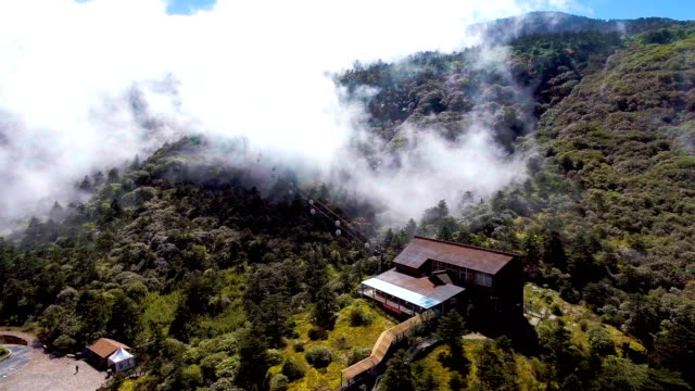 Cable Car Running on the Mountains with Fog Flowing, Jiaozi Mountaions, Yunnan Province, China video