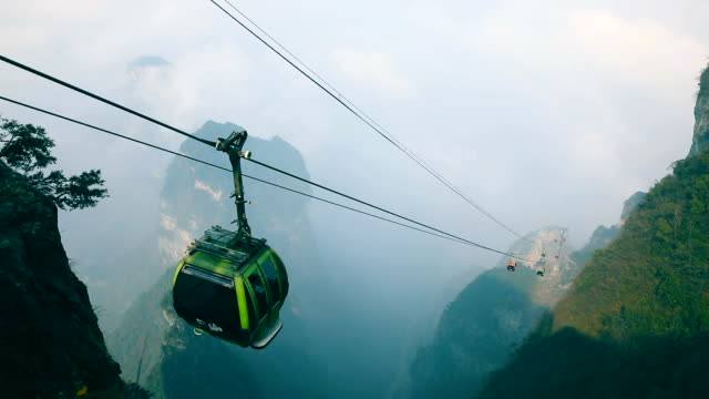 Cable cars moving up in mountain Cable cars moving up in mountain cable car stock videos & royalty-free footage
