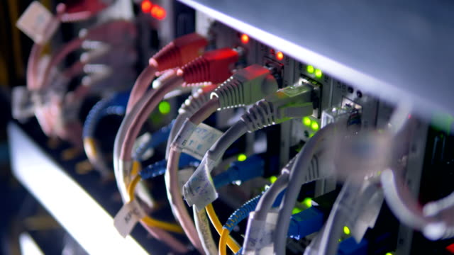 Cables plug to supercomputer for cryptocurrency mining. 4K. Cables plug to supercomputer for cryptocurrency mining. supercomputer stock videos & royalty-free footage