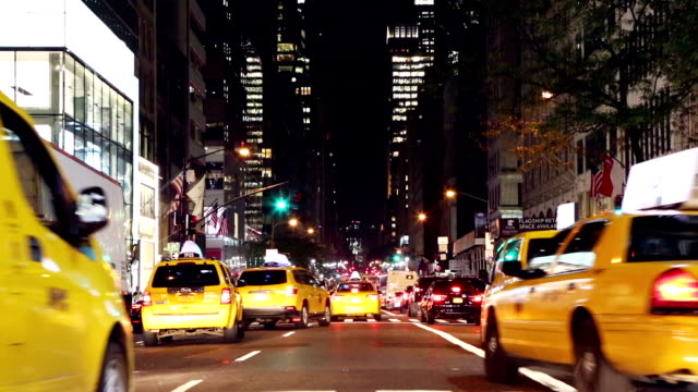 Cabs, cars, busses on 5th avenue, New York, USA video
