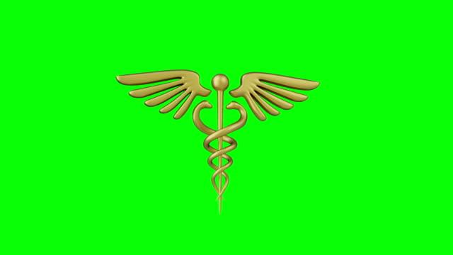 caduceus medicinsk symbol isolerad på en grön bakgrund. caduceus tecken med ormar på en medicinsk stjärna. 3d render - logotyp bildbanksvideor och videomaterial från bakom kulisserna