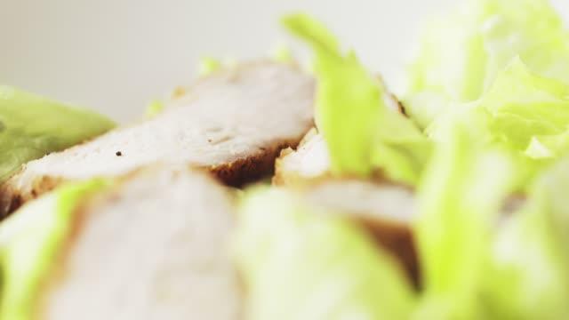 caesar salad closeup camera backwards fly follow falling croutons caesar salad closeup camera backwards fly follow falling croutons,   60fps prores footage salad bowl stock videos & royalty-free footage